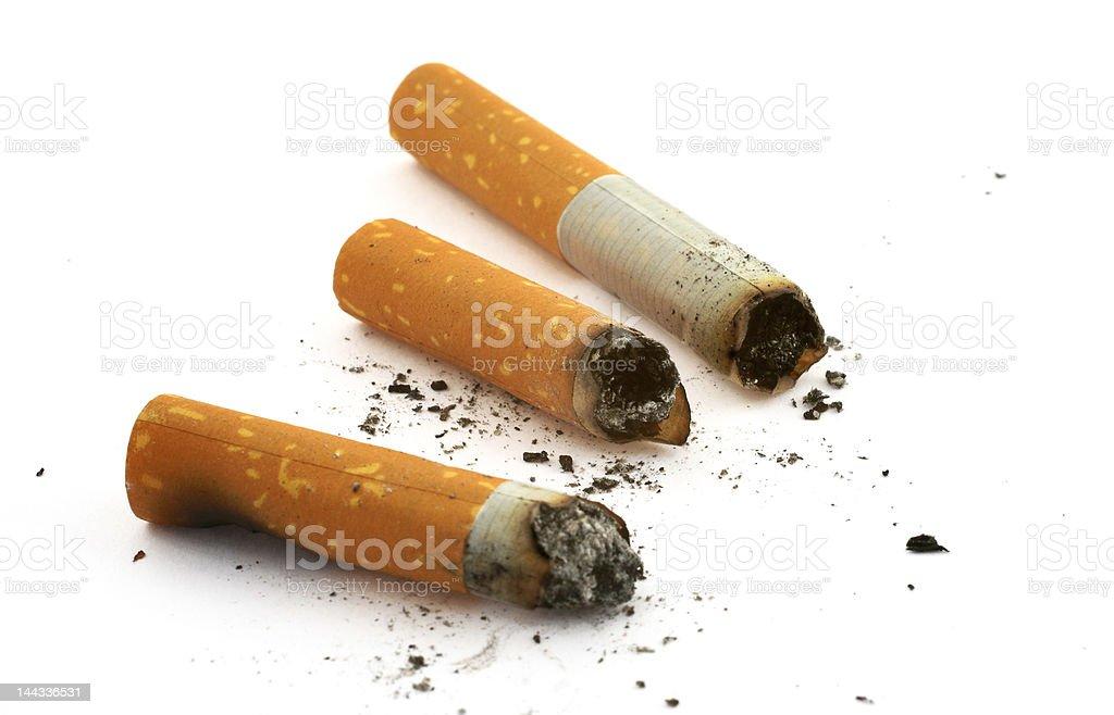 three cigarette butts stock photo