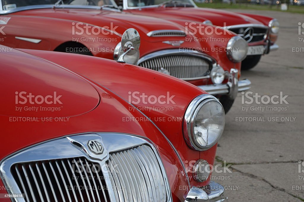 Three classic roadsters in a row stock photo