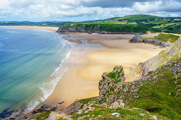 Three Cliffs Bay on Gower Three Cliffs Bay on Gower south wales stock pictures, royalty-free photos & images