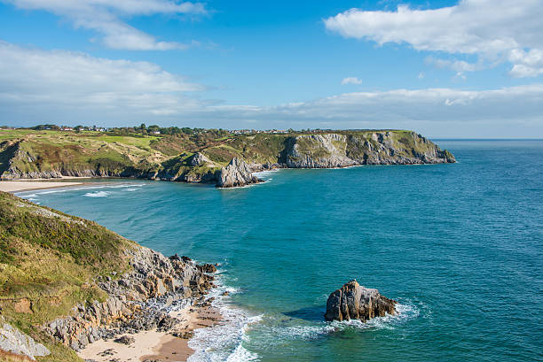 Three Cliffs Bay View View of Three Cliffs Bay in Wales from a hill top south wales stock pictures, royalty-free photos & images