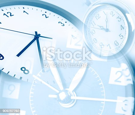 Three clock faces blended together. Blue tone