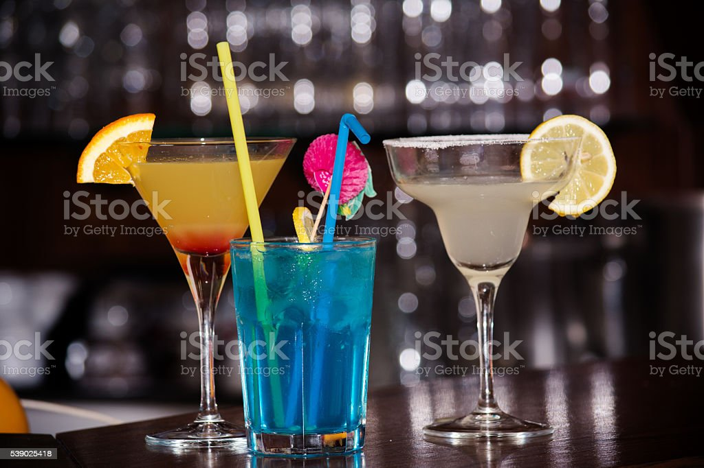 Three cocktails on a bar stock photo
