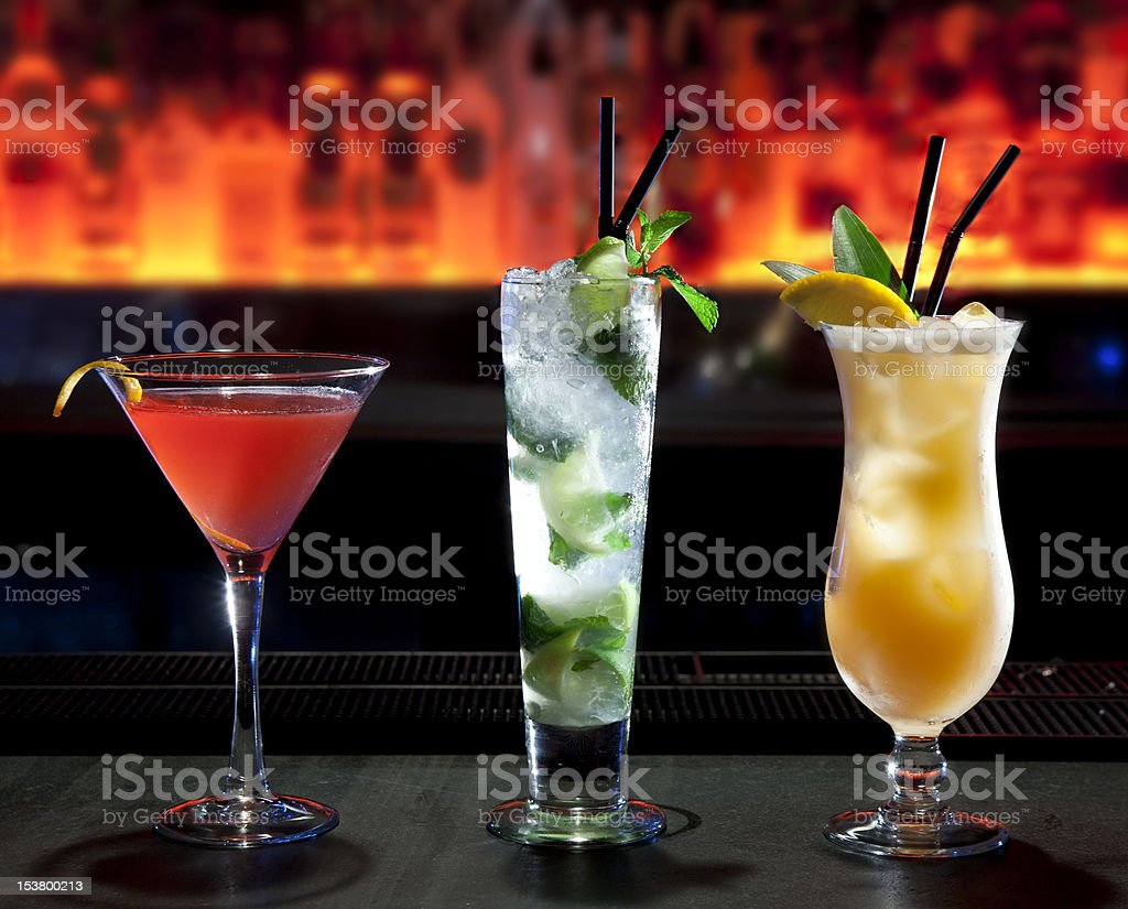 Three cocktails on the bar stock photo