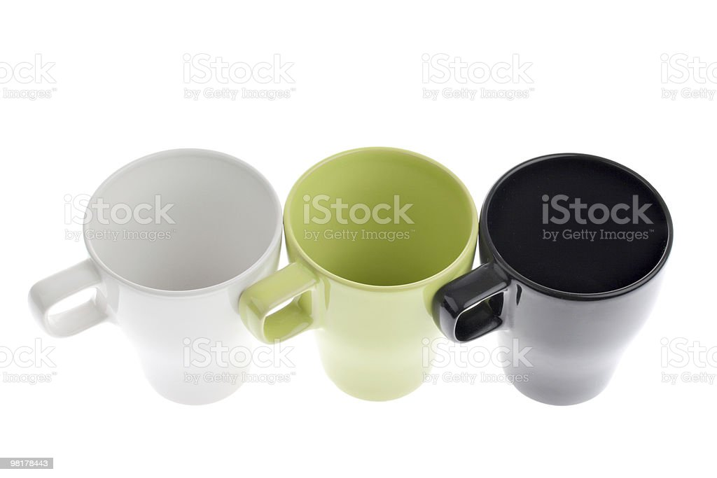 Three coffee cups in a row isolated on white royalty-free stock photo