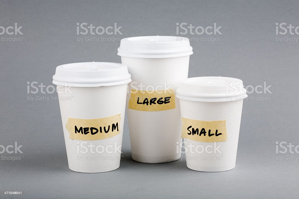 Three coffee cups sized small, medium, and large  stock photo