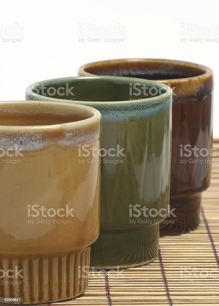 Three coffee cups vertical h royalty-free stock photo
