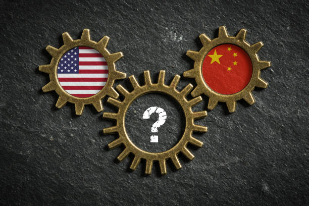 three cogwheels with the flags of USA and the China and a question-mark in the middle three cogwheels on slate background with the flags of USA and the China and a question-mark in the middle tariff stock pictures, royalty-free photos & images