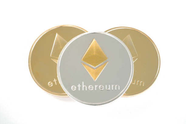 Three coins of Silver and golden Ethereum isolated on white background stock photo