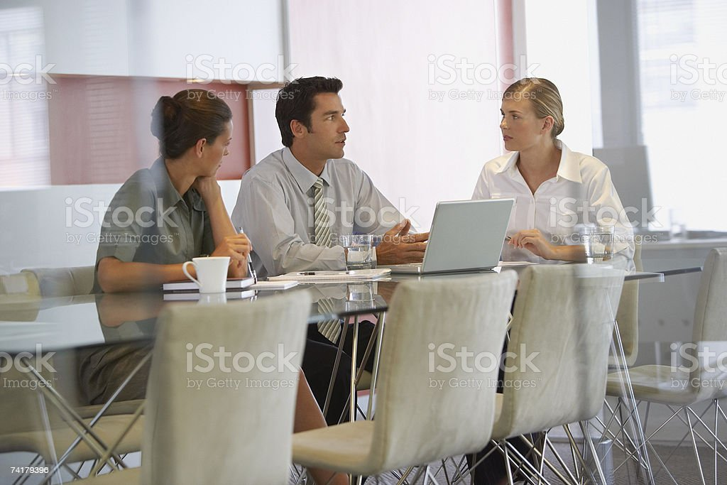 Three colleagues meeting stock photo