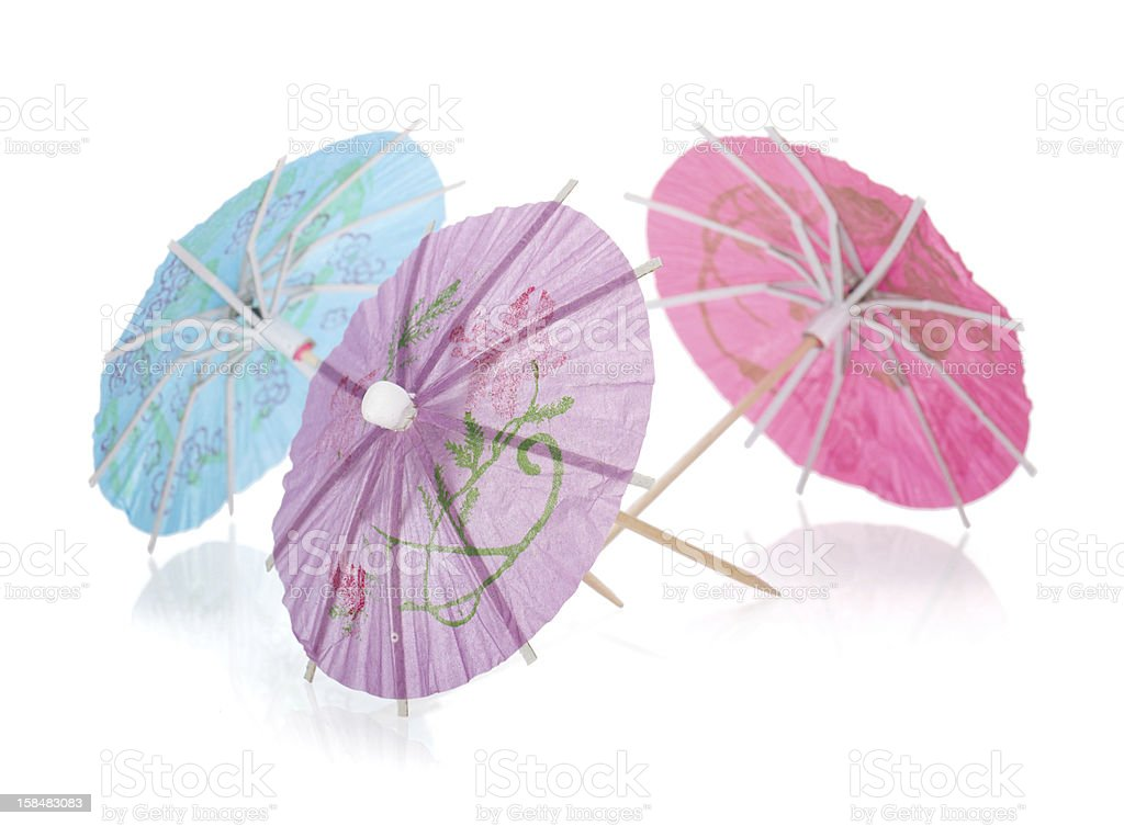 Three colored cocktail umbrellas royalty-free stock photo