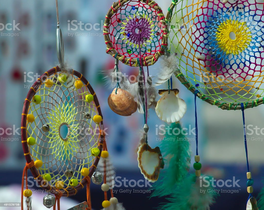 Three colored dreamcatchers hanging there stock photo