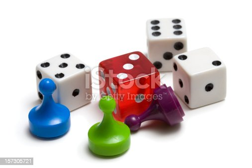 Three game pieces and four dice