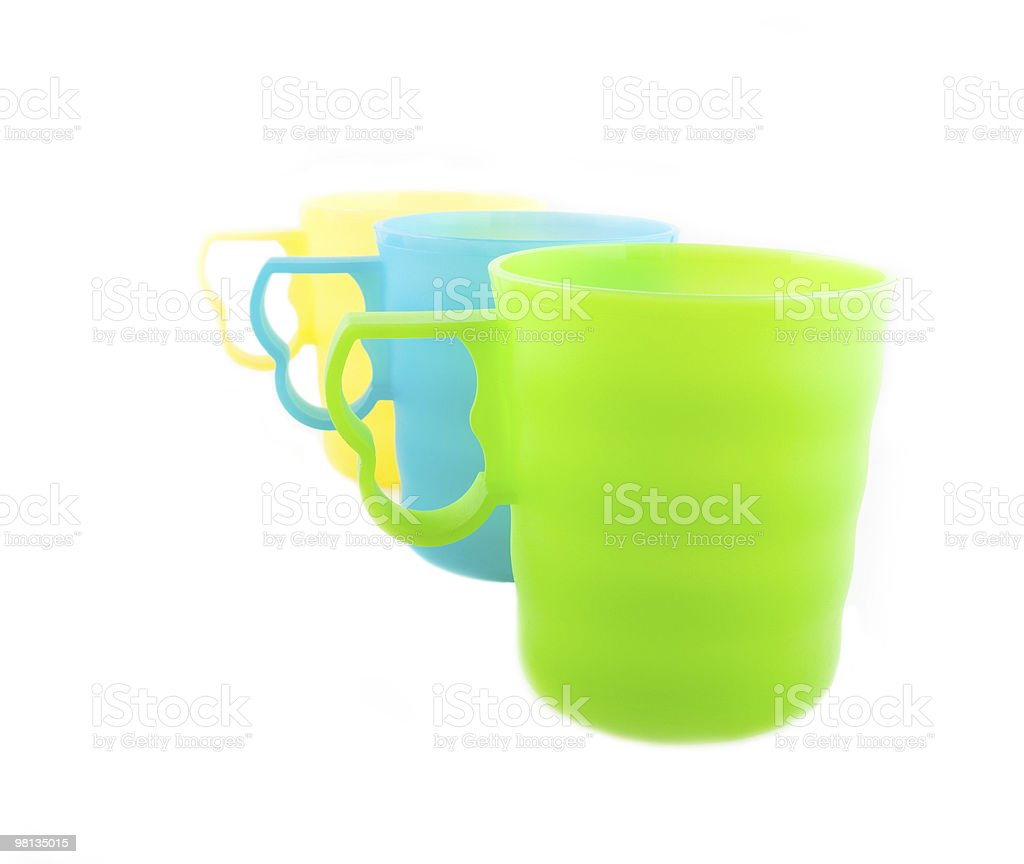 three colored plastic cups on the white royalty-free stock photo