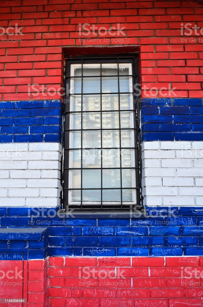 isolated Three colored wall with window, red, blue white brick...