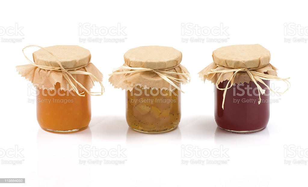 Three colorful bowls of jam lined up stock photo