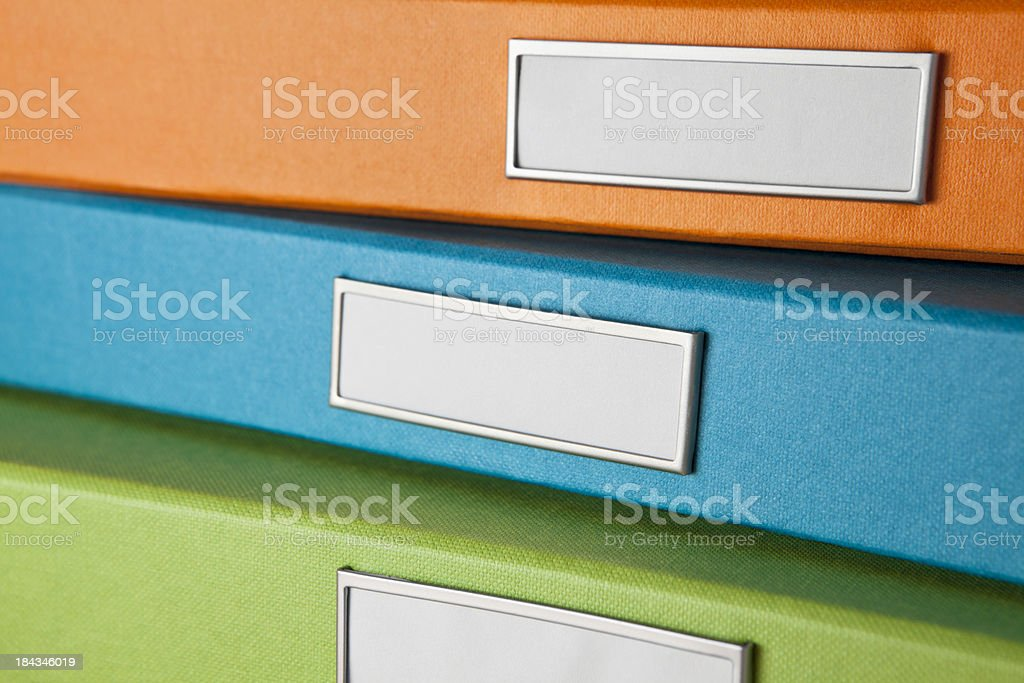 Three colorful file boxes stock photo