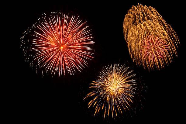 Three colorful fireworks bursts stock photo