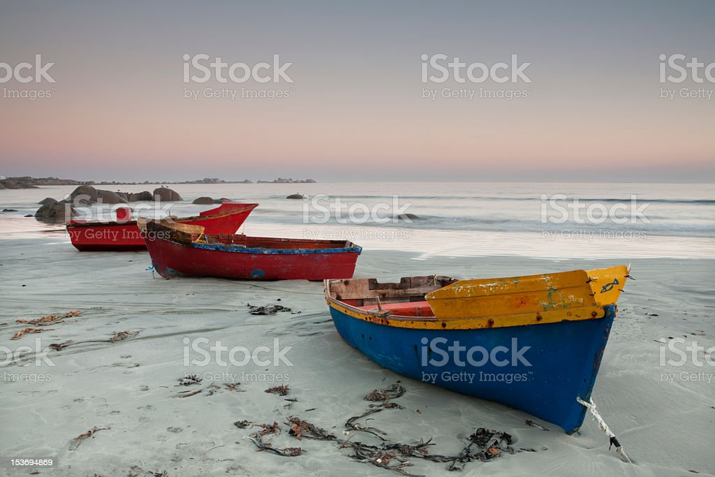 Three colorful fishing boats docked on the beach royalty-free stock photo