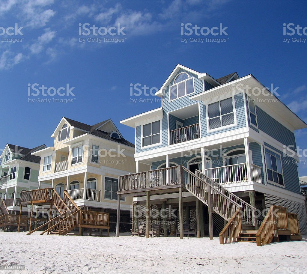 Three colorful houses on the beach stock photo