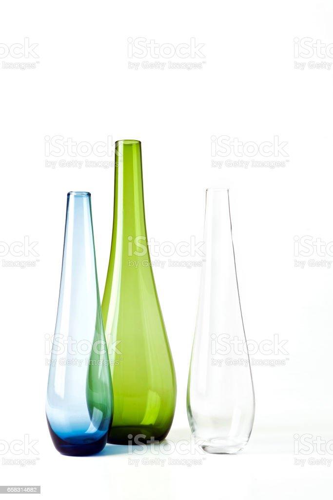 Three colorful jars on background – Foto
