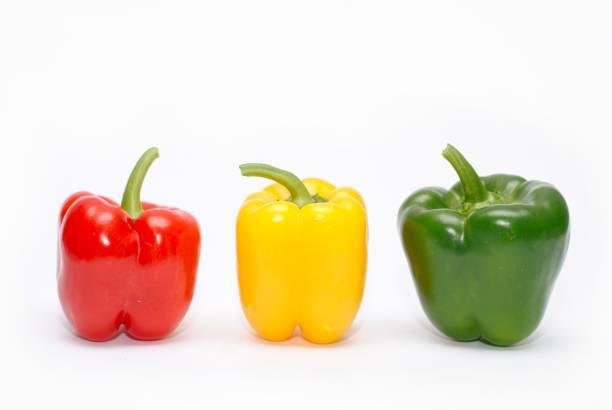 three colorful peppers - peperone foto e immagini stock