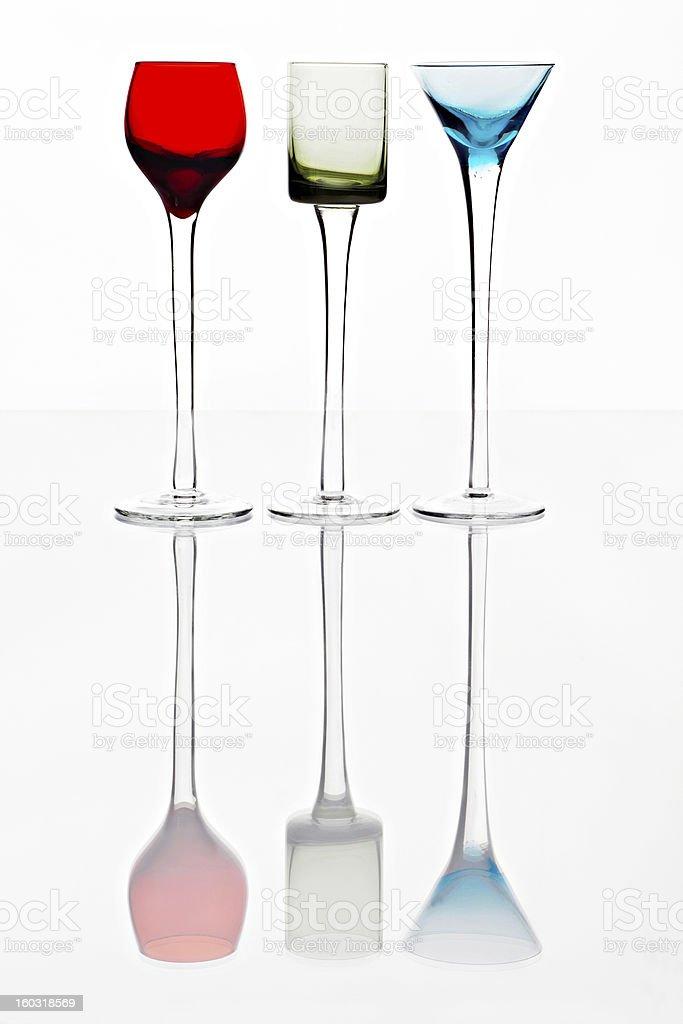 Three coloured cocktail glasses stock photo