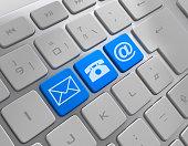 istock Three communication symbols on keyboard 1201366581