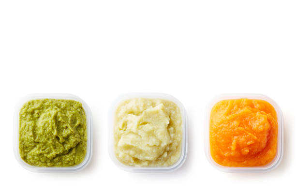 Three containers of baby puree isolated on white from above stock photo