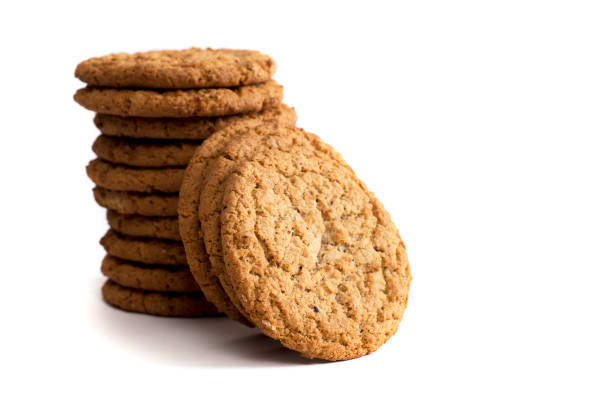 drei cookies gelehnt hohen stapel - hafer cookies stock-fotos und bilder