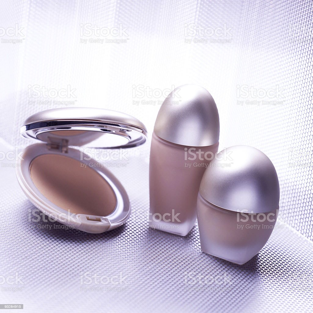 Three cosmetic objects on metallic background stock photo