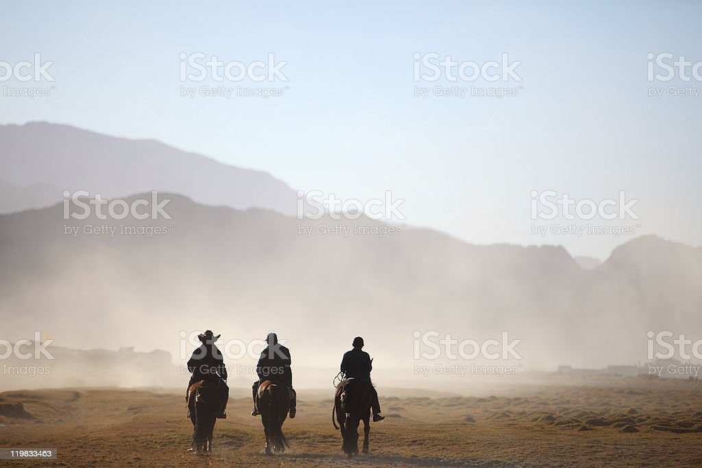 three cowboys stock photo