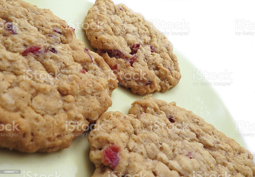 Three cranberry oatmeal cookies stock photo