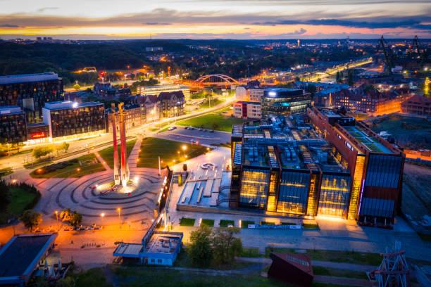 three crosses monument at the european solidarity square in gdansk, poland - drone shipyard night imagens e fotografias de stock