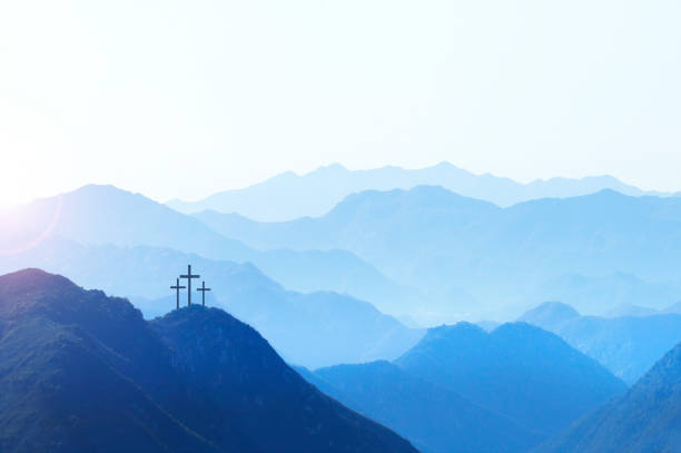 Three Crosses On A Hill At Sunrise stock photo