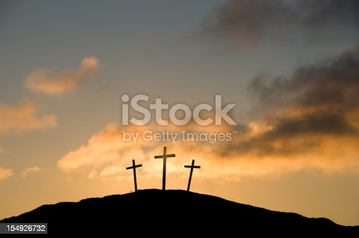 The Crucifixion at Calvary (Golgotha) near Jerusalem on Good Friday. Some copy space in the sunset.