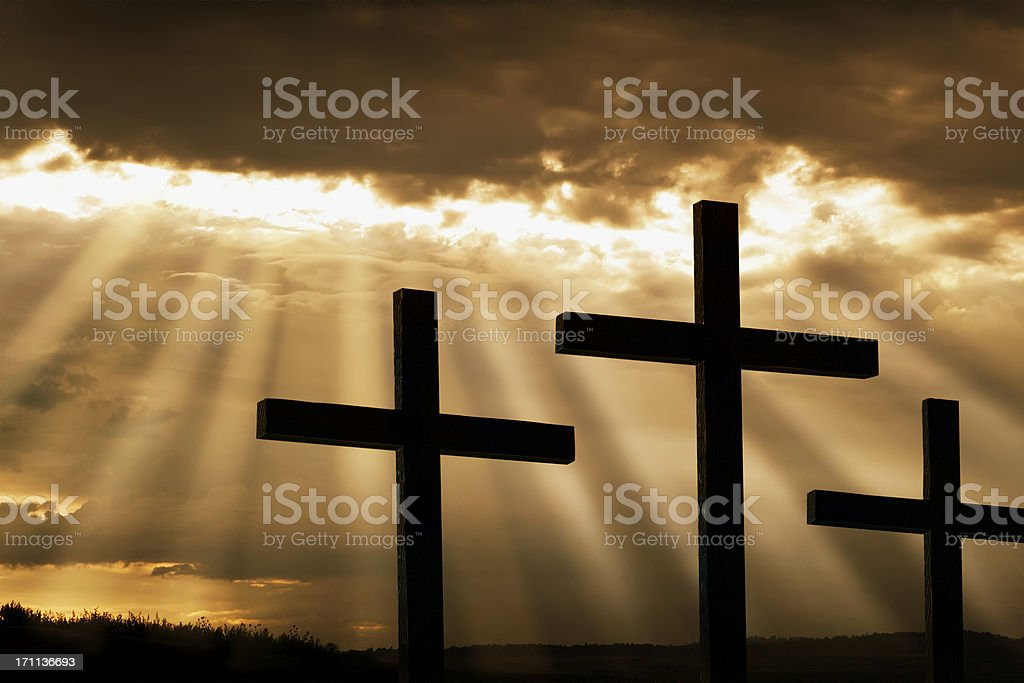 Three Crosses Silhouetted Against Breaking Storm Clouds royalty-free stock photo