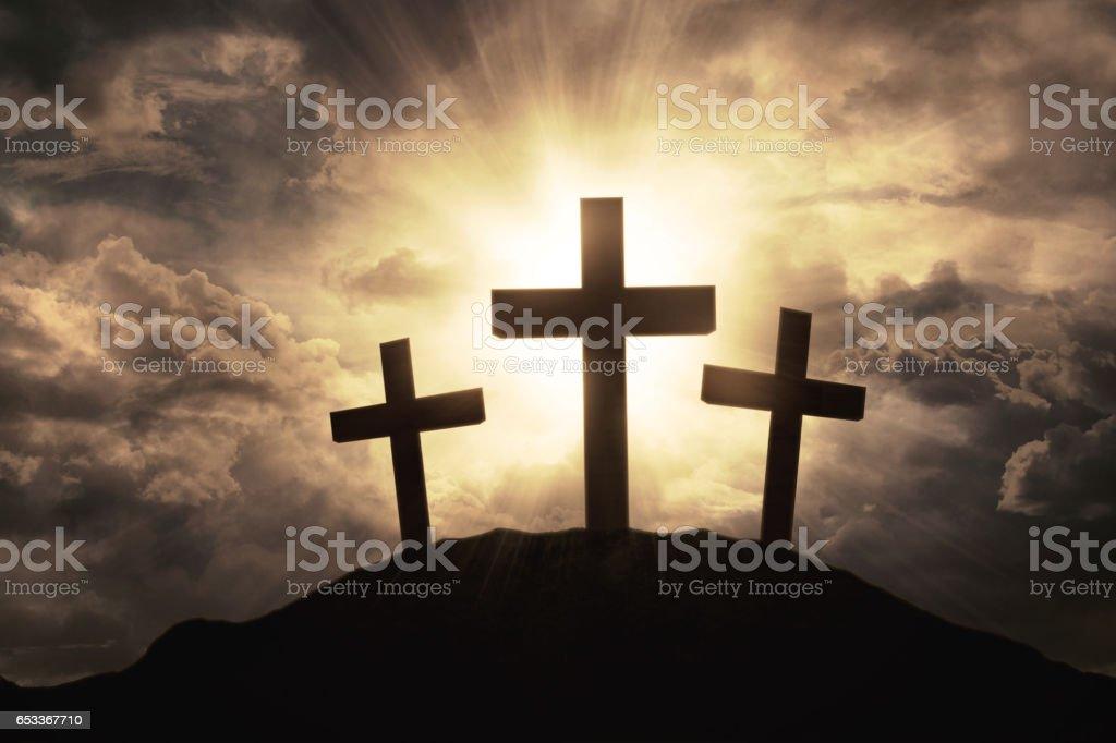 Three crosses symbol on mountain peak stock photo