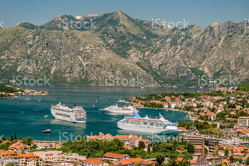 Three cruise liners in front of Kotor Port, stock photo