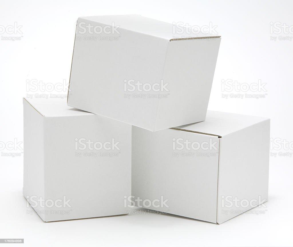Three cube shaped blank white cartons isolated royalty-free stock photo