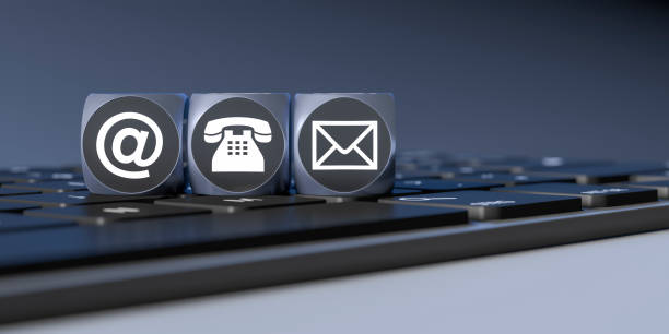 three cubes with signs for email phone and letter stock photo