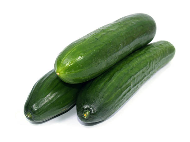 Three cucumbers on white background stock photo