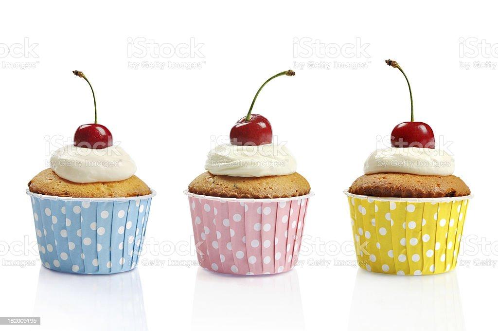 Three cupcakes and cherries stock photo