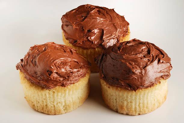 Three cupcakes on a white background stock photo