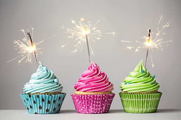 three cupcakes with sparklers - three objects stock pictures, royalty-free photos & images