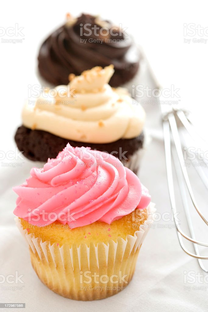 Three Cupcakes with whisk. royalty-free stock photo