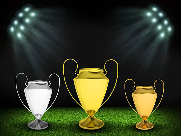 Three cups in the middle of field stock photo