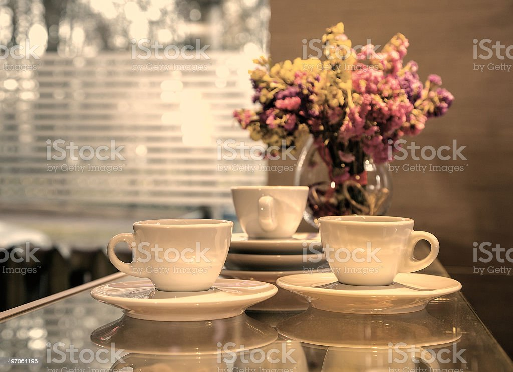 Three cups of coffee against the window stock photo