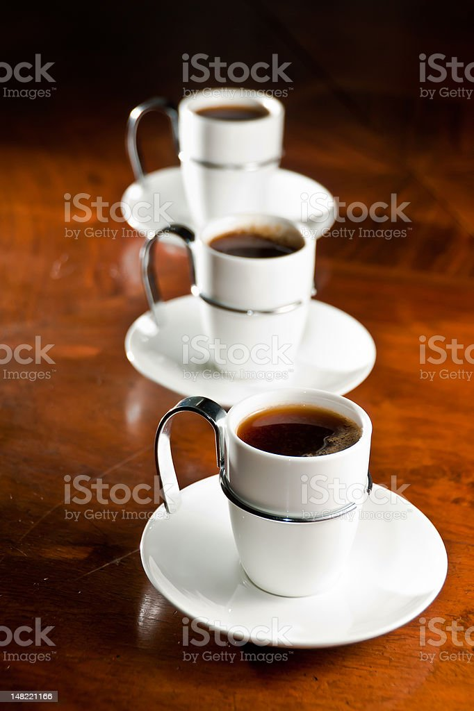 Three cups of hot coffee stock photo