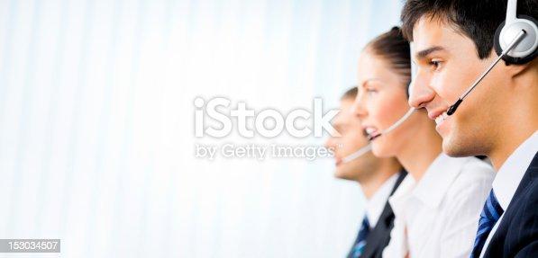 1167562098 istock photo Three customer support phone operators at office 153034507