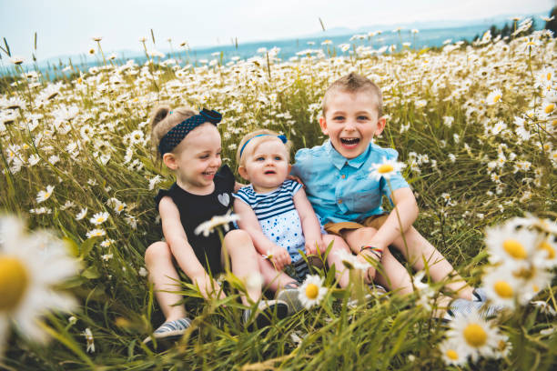 Three cute childs playing in green daisy field picture id1074949004?b=1&k=6&m=1074949004&s=612x612&w=0&h=ird8hov93sugr0trou5ha6fljn q fe6ocl2k8hrala=
